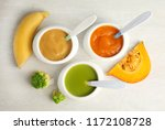 bowls with different baby food... | Shutterstock . vector #1172108728