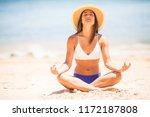 yoga woman meditating at serene ... | Shutterstock . vector #1172187808