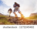 two tourists are going up at... | Shutterstock . vector #1172245402