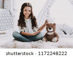 cute little girl sitting on... | Shutterstock . vector #1172248222