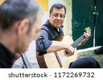 two fado guitarists with... | Shutterstock . vector #1172269732