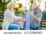 senior woman is getting gifts... | Shutterstock . vector #1172280982