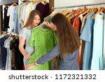 beautiful young women choosing...   Shutterstock . vector #1172321332