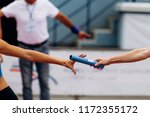 passing of baton from hand to... | Shutterstock . vector #1172355172