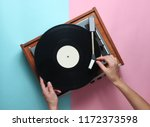 female hands  use retro vinyl... | Shutterstock . vector #1172373598