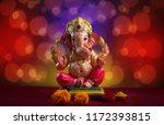 hindu god ganesha on blured... | Shutterstock . vector #1172393815