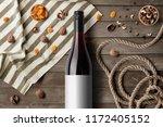 red wine bottle mockup on... | Shutterstock . vector #1172405152