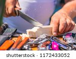 a sharp knife cuts the wood.... | Shutterstock . vector #1172433052
