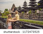 mom and son tourists in... | Shutterstock . vector #1172473525