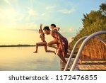 group of friends jumping into... | Shutterstock . vector #1172476855