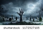 Stock photo zombie hand rising out of a graveyard in spooky night 1172527105