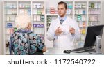 pharmacist man talking with old ... | Shutterstock . vector #1172540722