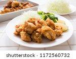 cooking fried chicken meat | Shutterstock . vector #1172560732