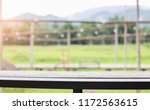 close up empty wooden table... | Shutterstock . vector #1172563615