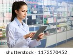 the pharmacist gives advice on... | Shutterstock . vector #1172570452