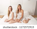 mother and daughter sitting... | Shutterstock . vector #1172572915