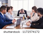 stressed boss having problem at ... | Shutterstock . vector #1172574172