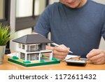 male customer calculate home... | Shutterstock . vector #1172611432