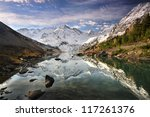 Reflection in a mountain lake - stock photo