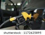 refill gas into the car tank... | Shutterstock . vector #1172625895
