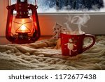 Red Oil Lamp And A New Cup Wit...