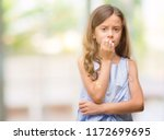 Stock photo brunette hispanic girl looking stressed and nervous with hands on mouth biting nails anxiety 1172699695