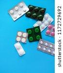 different pills on blue... | Shutterstock . vector #1172729692
