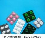 different pills on blue... | Shutterstock . vector #1172729698