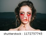 bloody halloween. woman with... | Shutterstock . vector #1172757745