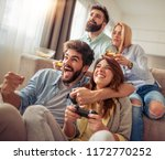 excited friends playing video... | Shutterstock . vector #1172770252