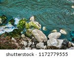 rocky sea shore and blue water. ... | Shutterstock . vector #1172779555