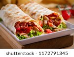 chicken bacon wraps with...   Shutterstock . vector #1172791345