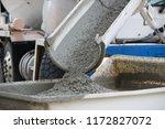 concrete mixer truck dumping a... | Shutterstock . vector #1172827072