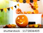 carved halloween pumpkin... | Shutterstock . vector #1172836405