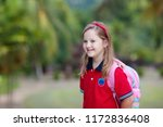 kid on her way back to school.... | Shutterstock . vector #1172836408