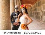 catrin and catrina in cemetery...   Shutterstock . vector #1172882422