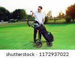 young man golfer taking out the ... | Shutterstock . vector #1172937022