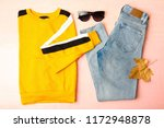 pullover and jeans on pink... | Shutterstock . vector #1172948878