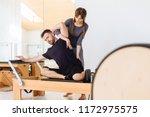 brunette female instructor with ... | Shutterstock . vector #1172975575