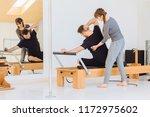 brunette female instructor with ...   Shutterstock . vector #1172975602