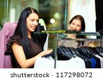 beautiful elegant woman shopping in clothes store - stock photo