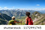 two women hikers on the trail... | Shutterstock . vector #1172991745