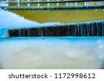 overflow of tha chomphu dam in...   Shutterstock . vector #1172998612