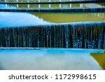 overflow of tha chomphu dam in...   Shutterstock . vector #1172998615