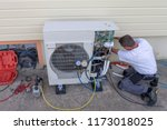 plumber at work installing a... | Shutterstock . vector #1173018025