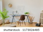 pouf and plants in white home... | Shutterstock . vector #1173026485