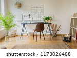 brown chair at desk with plants ... | Shutterstock . vector #1173026488