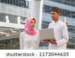 muslim woman is talking with... | Shutterstock . vector #1173044635