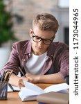 teenager boy doing homework at... | Shutterstock . vector #1173044965