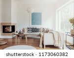 modern corner fireplace in a... | Shutterstock . vector #1173060382